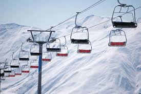 ski lift chairs on bright winter day stock photo