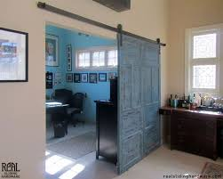 office barn doors. this blue barn door separates an office space and entertainment room doors