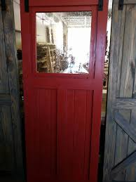 single sliding barn door with seeded glass window
