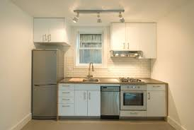 Compact modern kitchen dark cabinets and shiny mosaic tile