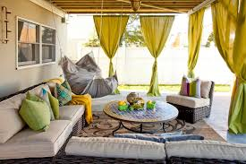 eclectic outdoor furniture. Fantastic Eclectic Patio With Hanging Chair Next To Wicker Outdoor Furniture And Round Mosaic Tile Coffee Table On Beige Patterned Rug Plus Green C