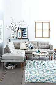 white living room grey couch grey sofa blue and white patterned rug origami coffee table mid white living room grey couch
