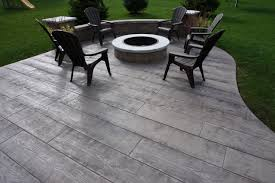 colored and stamped concrete home of ageless colors release patterns wood stamped concrete patterns patio