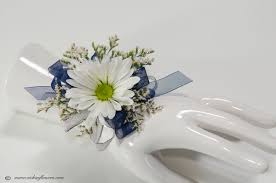 prom 042 25 plus tax and delivery white and blue wrist corsage with white daisies blue ribbon and white limonium and studded jeweled wrist band