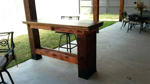 deck rail tables turn your deck railing into a bar by retrofitting your wooden top rails deck rail