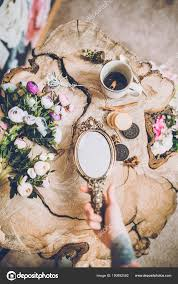 hand holding antique mirror. Close-up Of Human Hand With Tattoo Holding Beautiful Vintage Mirror Near Spring Flowers \u2014 Photo By KristinaPonomareva Antique E