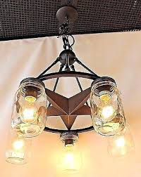 5 light clear mason jar lighting lone star chandelier in rubbed bronze finish wagon wheel for 6 hand made mason jar chandelier