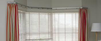 image of bay window curtain rod ideas