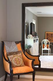 Living room greige greige walls (Farrow Ball Mouse's Back) plus orange  accent plus light floors and white baseboard