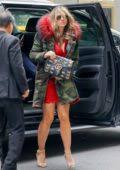 Elizabeth hurley stunned in a purple coat as she stepped out in london. Elizabeth Hurley Steps Out In A Short Red Dress With Fur Trimmed Camo Jacket In New