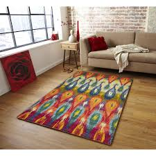 bright area rugs with ikat rug and hardwood flooring also mid century end table sofa brick accent wall plus window treatment living room geometric decor