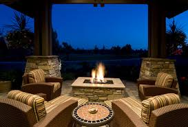 Covered patio with fire pit Arts Crafts Style Square Flagstone Fire Pit With Flat Top On Patio With Matching Flagstones Home Stratosphere 42 Backyard And Patio Fire Pit Ideas