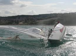 Image result for sailboat knocked down