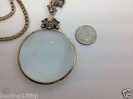 vintage avon magnifying glass pendant