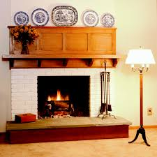 using solid oak wood door shelf over fireplace including white brick fireplace surround and round blue plates arts and crafts fireplace mantel