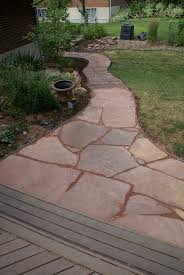 this is a patio with concrete base and an edge
