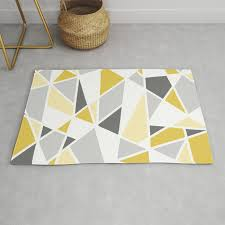 geometric pattern in yellow and gray rug