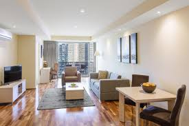 Melbourne Hotel Apartments Out View Of Living Room In 1 Bedroom Holiday  Flat With Couches,