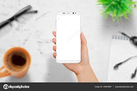 Woman holding white modern smart phone with isolated screen White