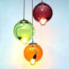 blown glass pendant lighting hand