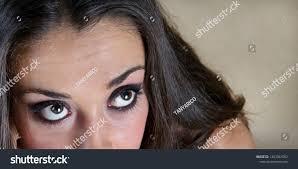 beautiful big brown eyes with beautiful makeup looks away up close up