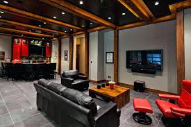 bright man cave ideas with black leather sofa and red lounge chair light brown wooden coffee