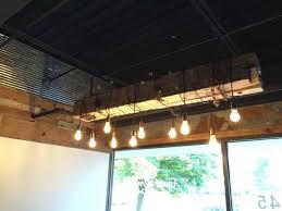 barn wood beam rustic chandelier chandeliers wood lamps