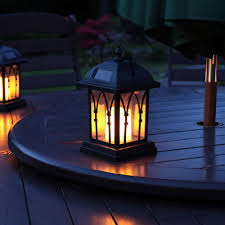 black solar candle lantern 27cm on table