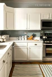 White Kitchen Cabinets White Counter Tops Blue Gray Backsplash 12