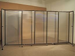 Our sliding partition wall with semi-transparent polycarbonate panels -  lightweight, durable, attractive, and washable, perfect for schools.