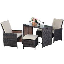 picture of outdoor rattan patio set furniture cushioned with ottoman 5 pieces brown