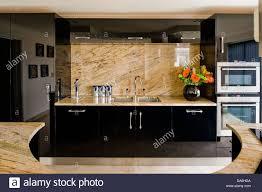 Black Splashback Kitchen Pale Marble Splash Back And Worktop On Black Fitted Unit In Modern