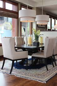inspired wingback dining chair in dining room transitional with double chandeliers next to dining room carpet