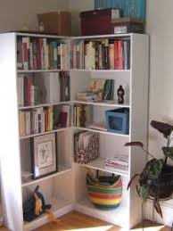 corner unit using 2 ikea billy bookcases. And you can hide stuff in that  corner
