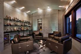 interior man cave ideas with big wall shelf for drink place and 4 padded brown