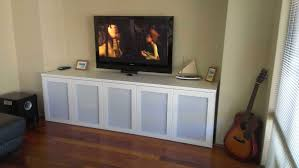 affordable ikea media storage white painted wooden credenza tv french console server frosted glass door cream wall paint blind window treatment laminate
