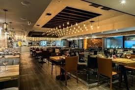 rustic wine bar opens in fort featuring cuisine house cured barrel chandelier rustic wine