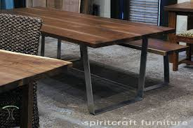 a black walnut slab dining table and bench with bent stainless steel legs by spiritcraft design furniture dundee il copy