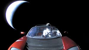 tesla roadster in e with e suit man e x