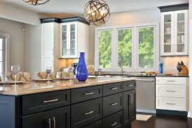 beautifully designed open floor plan kitchen features painted shaker style cabinetry by cliqstudios shown dayton
