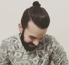 a picture of a hipster with a thick beard and a top knot hairstyle