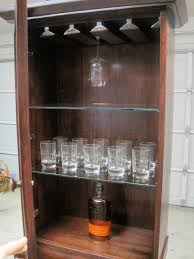 furniture tall brown wooden wine glass storage with transpa glass board shelf outstanding ideas