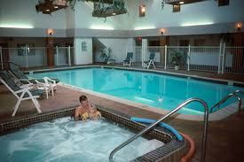 indoor pool and hot tub with a slide. Pool / Hot Tub Sauna - All Counties Indoor And With A Slide