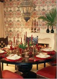 romantic moroccan dining room design with wooden round dining table wooden chairs candles on table and chandeliere image