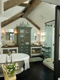 a vintage farmhouse bathroom with wooden beams vintage furniture a shower and a free