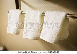 hanging white towel. Three Hanging White Towels In The Bathroom - Csp54595059 Towel E