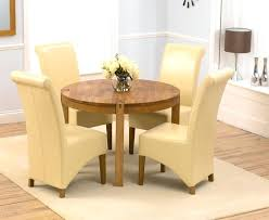 solid oak round dining table with cream chairs cky and four