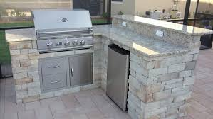 summerset appliance and a stone veneer outdoor kitchen lakewood ranch grill closed