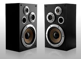 speakers stereo. a pair of stereo speakers with exposed speaker cones, turned slightly inwards