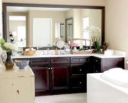 Adding A Frame To Existing Mirrors Is An Easy And Inexpensive Upgrade - Trim around bathroom mirror